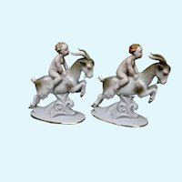 Pair of vintage figural porcelain rams and riders/Germany