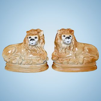 Pair of Antique Pottery Staffordshire Recumbent Lions