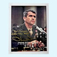 Oliver North, USMC signed and inscribed color photograph