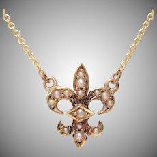 14 KT. Yellow Gold and Split Pearl Fleur De Lys Necklace