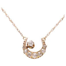 14 KT. Gold and Old European Diamond Crescent Necklace