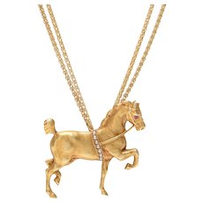 Elegant Horse Pendant Suspended from a Double Gold Chain