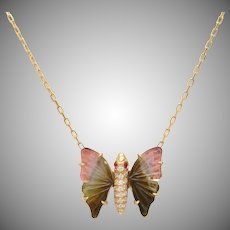 Watermelon Tourmaline Butterfly set in 18 KT with Pave set Diamonds and Rubies