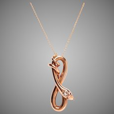 Rose Gold Serpent Necklace with Diamond and Ruby Detail