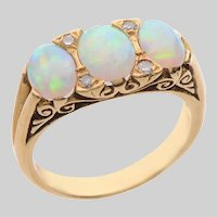 3 Stone Cabochon Opal and Diamond Ring set in 18 KT. Gold