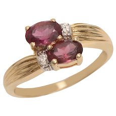 Garnet and Diamond Bypass Ring set in 14 KT Gold
