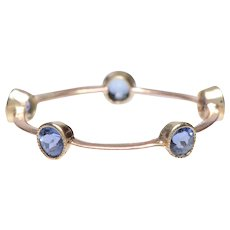 Delicate 18 KT Gold Band of Bezel set Sapphires