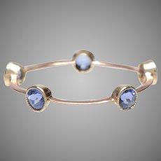 Delicate 18 KT Gold Band of Bezel set Sapphires