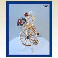 Vintage Trifari Real Look Flower Peddler on Bicycle Figural Brooch Pin Rhinestones