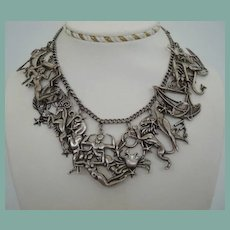 Magnificent RARE MARGOT DE TAXCO Sterling Silver Zodiac 12 – Figural Cut-Out Pendants Necklace