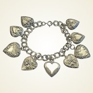 Vintage Sterling Silver Puffy Hearts 9 Charm Bracelet