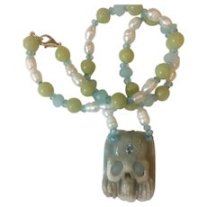 Carved Natural Amazonite skull pendant necklace: Aquamarines, Topaz and Apatite