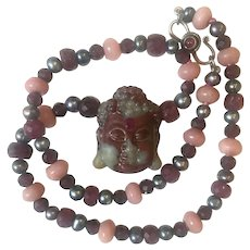 African Bloodstone Carved Guan Yin, Ruby, Cultured Pearl, leather cord Necklace