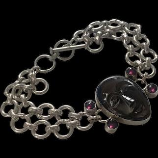 Carved Black Onyx Face sterling and Garnet bracelet
