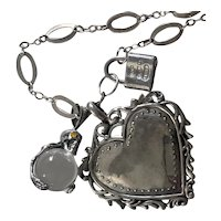 Large Sterling Pools of Light skull, Heart and Tiffany Lock necklace