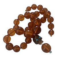 Natural Baltic Amber Bead & carved skull