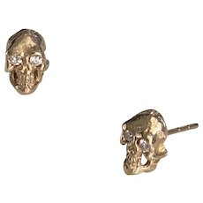 Solid 14 K gold Skull studs with natural diamonds
