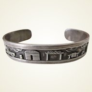 Traditional Navajo Sterling Silver Storyteller Cuff Bracelet signed by master silversmith, R. H. Begay.