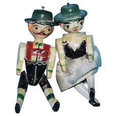 Teeny Pair of Antique German Erzgebirge Peg Wooden Penny Dolls In Painted Ethnic Costume