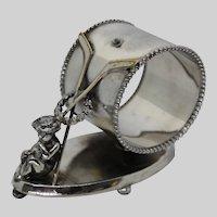 Antique Figural Napkin Ring Hockey Sticks Meriden Silverplate Cherub