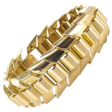 18 Karats Yellow Gold articulated tank bracelet with ears of wheat links