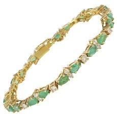 1980s 18 Karats Yellow Gold Diamonds Emeralds Tennis Bracelet
