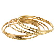 1950s 7-Day 18 Karat Yellow Gold Bangle Bracelet