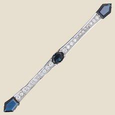 1930s Art Deco Diamond Sapphire 18 Karat White and Yellow Gold Bar Brooch