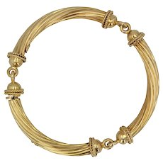 1960s 18 Karat Yellow Gold Articulated Bangle Bracelet