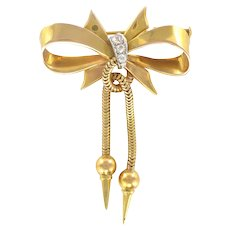 1950s Diamond 18 Karats Yellow Gold Tank Tubogaz and Bow Brooch