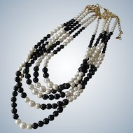Necklace of Simulated White Pearls and Black Beads