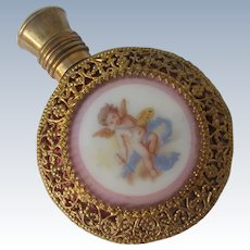 Cranberry Glass Perfume Bottle with Filigree and Cherub on Porcelain