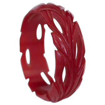 Art Deco C1925-35 Cherry Red Bakelite bangle with deep leaf carvings and cut outs. Beautiful, easy to wear, and like all Vintage Times Bakelite, genuine