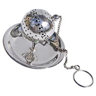 19th Century American Sterling Silver Tea Ball With Circular Tripod Holder And Finger Loop