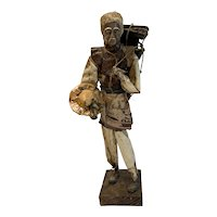 Interesting Folk Art Paper Mache Figure of a Man Carrying a Load of Boxes