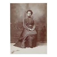 Cabinet Photograph of Woman, Seated in Victorian Dress
