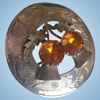 Sterling Silver Scottish with double teasel with citrine colored glass.