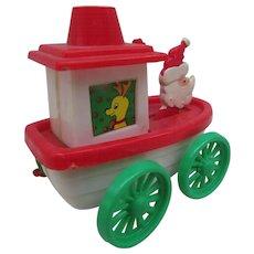 Vintage Christmas Ornament Made in Hong Kong. Santa Tug Boat with Wheels