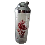 Needle point rose pattern glass shaker with four matching glasses.
