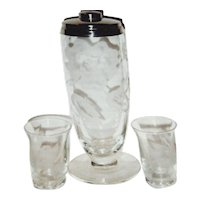 Etched flowers on clear glass shaker with four glasses