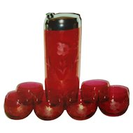 Dark ruby stain shaker with glasses.