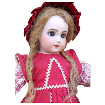 Adorable antique Red Riding Hood Jumeau Bebe and the Wolf.