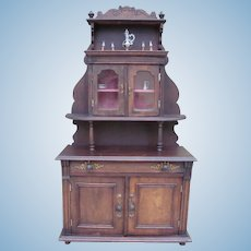 Beautiful antique wood cabinet with accessories for antique dolls.