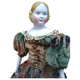 Nice antique German  bisque lady doll with rare turned head.