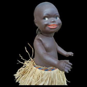 As found smiling  German black doll