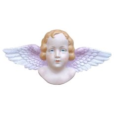Antique and large bisque angel.