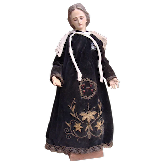 Nice antique Madonna in original gown.