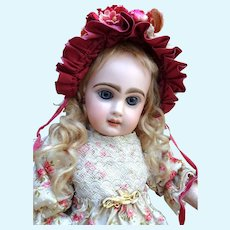 Adorable open mouth Jumeau Bebe with rare marking and original dress.