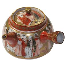 Antique Japanese Teapot Painted with Immortals in Kutani Style