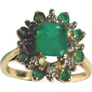 Exquisite 14k Yellow Gold Ring with Center Emerald Surrounded by Smaller Emeralds and Diamonds
